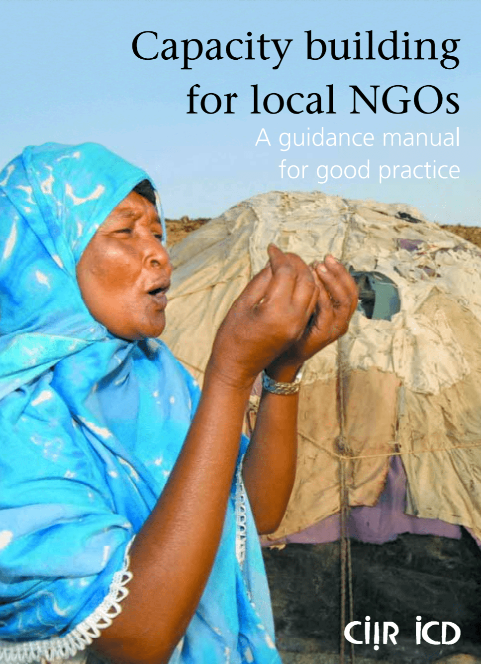 """The image shows the cover of the manual titled """"Capacity Building for Local NGOs: A Guidance Manual for Good Practice"""". A woman with a bright blue head covering stands outside, mouth open as if speaking, gesturing with her hands."""