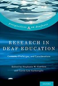 "Image shows the cover of the book ""Research in Deaf Education: Contexts, Challenges and Consideration"" The title is in white print on a background showing blue waves of water."