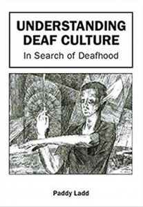"Image shows the cover of the book ""Understanding Deaf Culture: In Search of Deafhood"" by Paddy Ladd. Below the title is a black and white drawing of a man who is moving his hands. From behind him, you can see hands touching his ears."