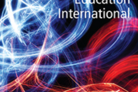 """Image shows the cover of an issue of a journal called """"Deafness & Education International"""". Cover of Deafness and Education International:. The background is in black with swirls of white red yellow and blue lights sweeping across the page in abstract curvy patterns."""