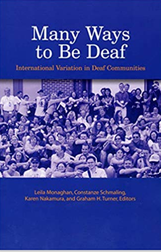 "Cover of the book entitled ""Many Ways to be Deaf: International Variations in Deaf Communities"". Below the title is a photo that shows a large group of Deaf people. Many people in the picture have one hand on the shoulder of the person next to them."