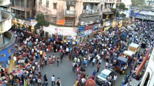 Screenshot from a video about deaf people in Mumbai, India. Shows a large crowd of people in the streets of the city.