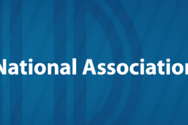 """The logo for the National Association of the Deaf (NAD) in the United States. At the left, the acronym """"NAD"""" is inside a circle. At the right is the name of the organization."""