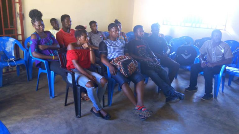 a group of youth are watching a lecture