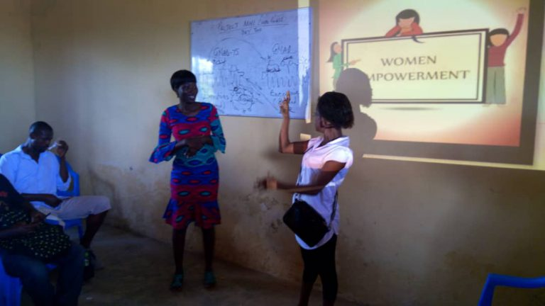 two females giving a presentation