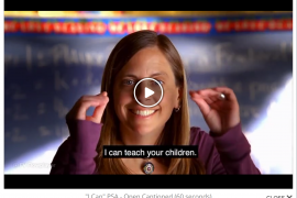 "Screenshot of a video frozen on the face of a woman who is signing to the camera. The caption at the bottom of the video screen says ""I can teach your children."""