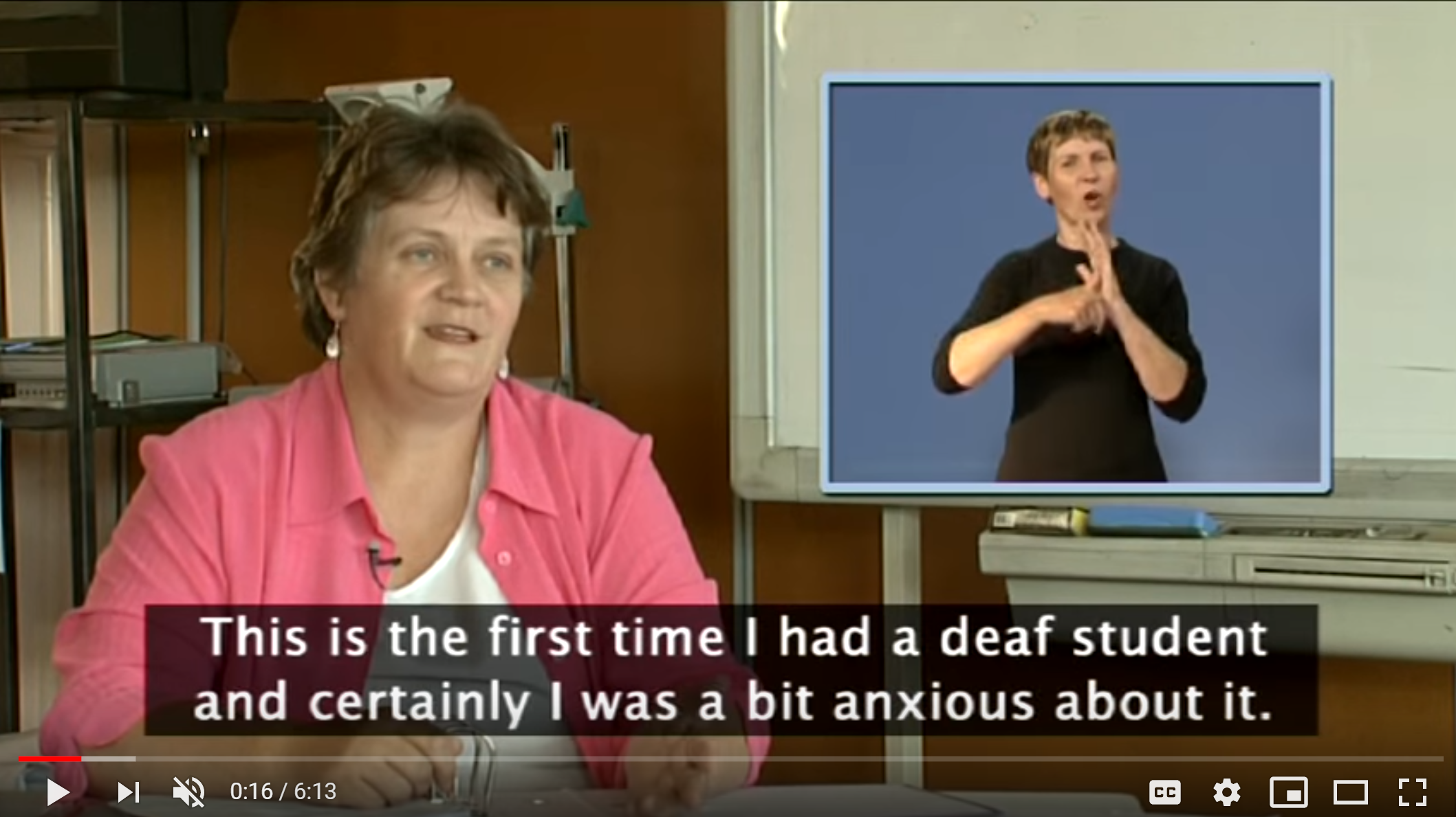 """Screenshot from a captioned video in which a woman is saying, """"This is the first time I had a deaf student and certainly I was a bit anxious about it."""" An Australian Sign Language interpreter is shown in the corner of the screen."""