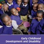 "Screenshot of the publication entitled ""Early Childhood Development and Disability: A discussion paper"". Above the title is a picture that shows many children clustered together, smiling up at the camera. In the middle, one boy uses a wheelchair."