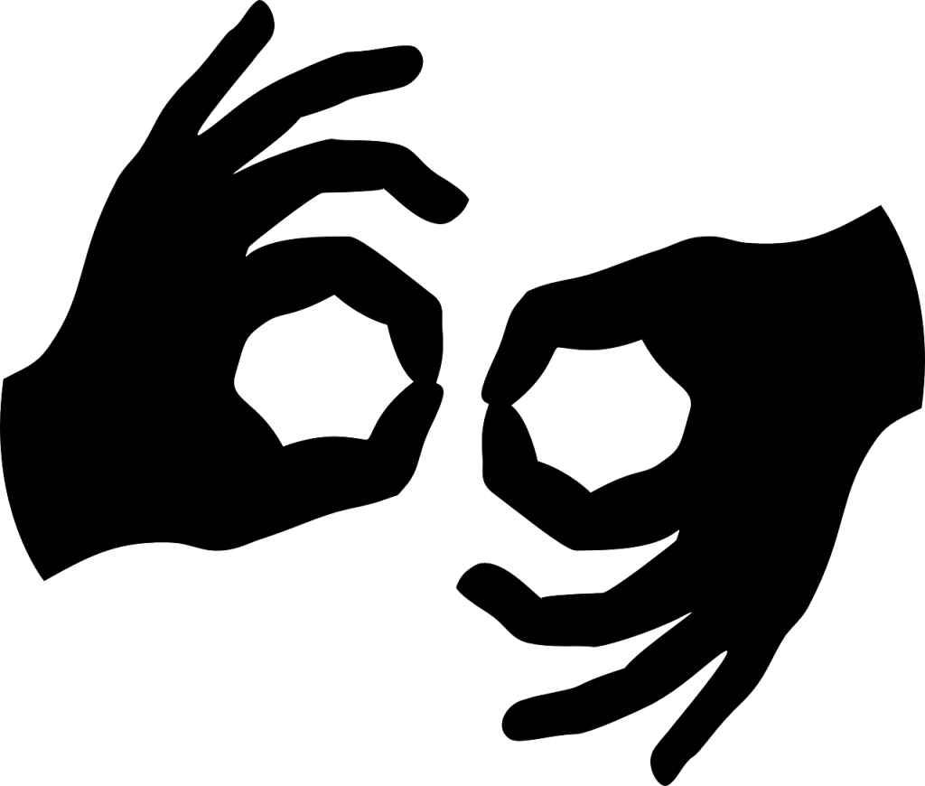 "A silhouette drawing shows two hands configured in the position used to indicate ""sign language interpreter""."